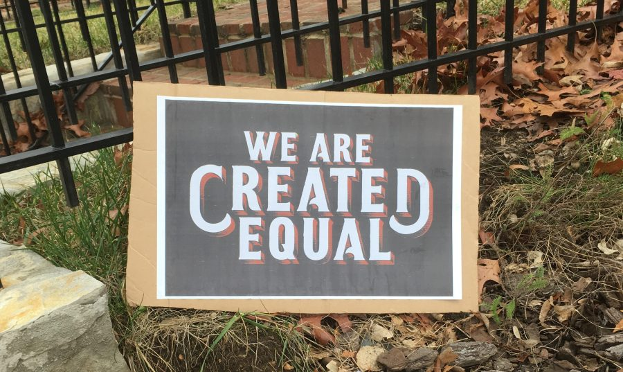 """We are created equal"" sign"